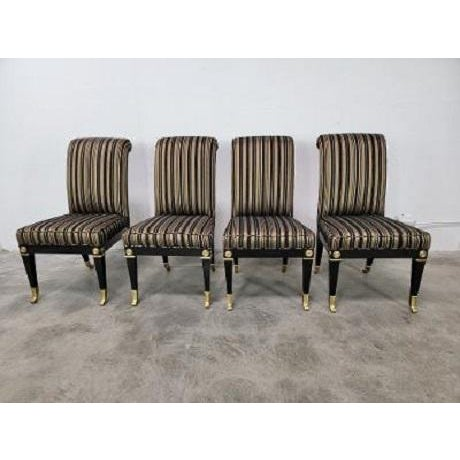 Hollywood Regency Glam Elegant contours of these fantastic black lacquered and brass chairs by Mastercraft. The chairs...