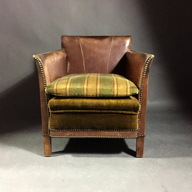 Exceptional Swedish club chair from the early 1940s designed with a deep box shape, tight leather construction, slightly...