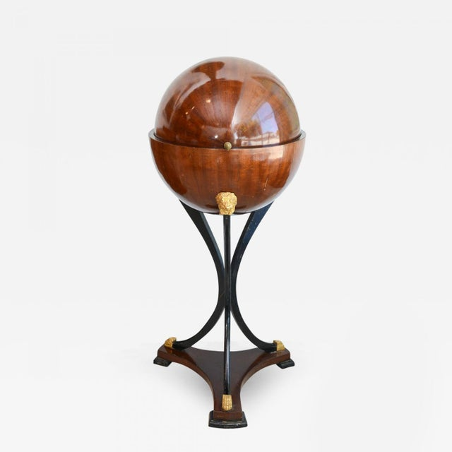 The acorn finial (later), above a globe that opens to reveal a fitted interior, with secret compartments, on tripartite...