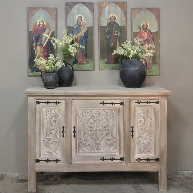 Antique Gothic Whitewashed Oak Buffet was hand-crafted to last for generations, and features finely carved bas relief on...