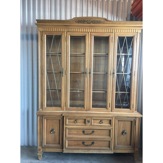 A beautiful French Provincial china cabinet by Thomasville with glass doors, drawers, and lower cabinet storage. Separates...