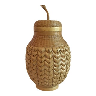 1950s Chinese Pear Shaped Woven Wicker Encased Terra Cotta Jar For Sale