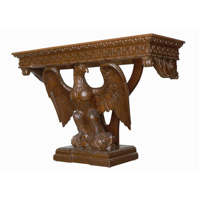 American neoclassical hand-carved console table. The rectangular oak top is supported by an eagle with spread wings...
