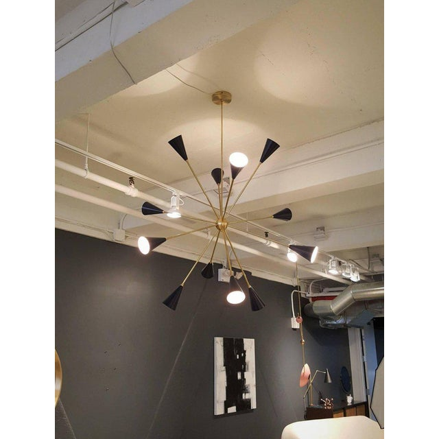 """Wildly sculptural model 820 """"Spore"""" chandelier in unlacquered brass and dark blue high-gloss enameled spun aluminum cones..."""