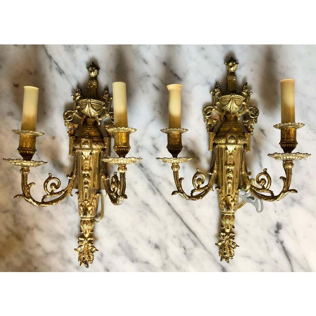Pair of English Adam style finely cast bronze dore wall sconces each having two lighted arms.