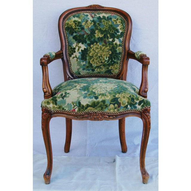 Circa 1940s Louis XV-style carved solid walnut French-style armchair newly upholstered in vintage/never used luxurious...