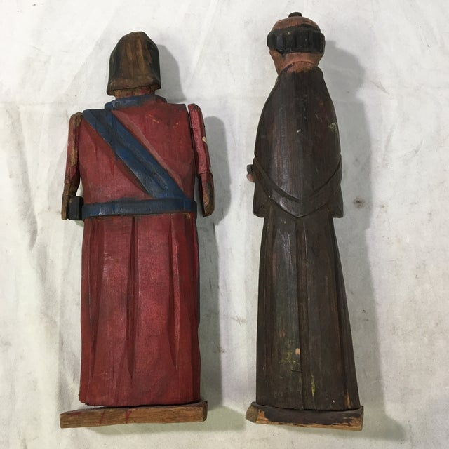 These two vintage Christian figures were carved out out of wood and painted by hand. Their style (particularly the way...