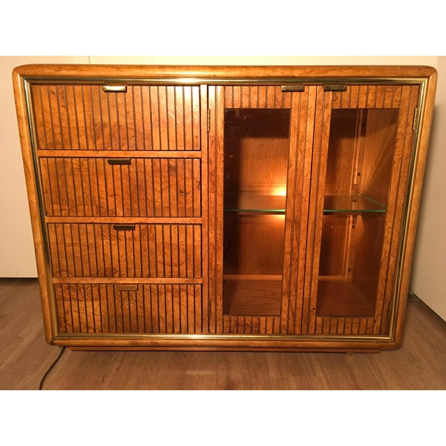 Its a funky 'somewhere from mid-century to 80's Dallas (the show) bar cart/cabinet. ' If you can't see J.R. Ewing pouring...
