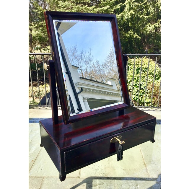 Handsome midcentury Asian rosewood lacquered dressing table mirror. Quality brass hardware with elegant lock. Beveled...