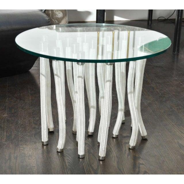 Round glass coffee table by Fabio Novembre.