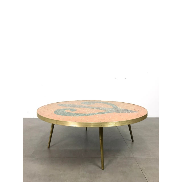 Stunning vintage round tile table c1950's. Italian modern style with brass banding and tapered legs, surfaced with an...