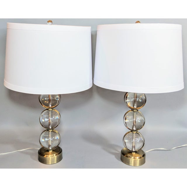 This Set of Two (2) Global Views Crystal Ball Lamp in Brass With Linen & Gold Lined Shade creates an illumination...