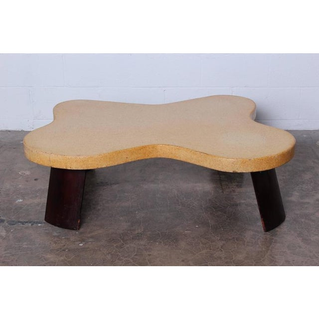 A rare amoeba cork-top coffee table with mahogany legs. All original with a nice even patina. Designed by Paul Frankl for...