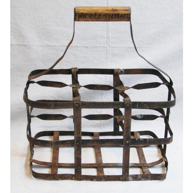 French metal bottle carrier with wood handle. Holds up to six bottles. No maker's mark. Some scuffs, age wear, oxidation....