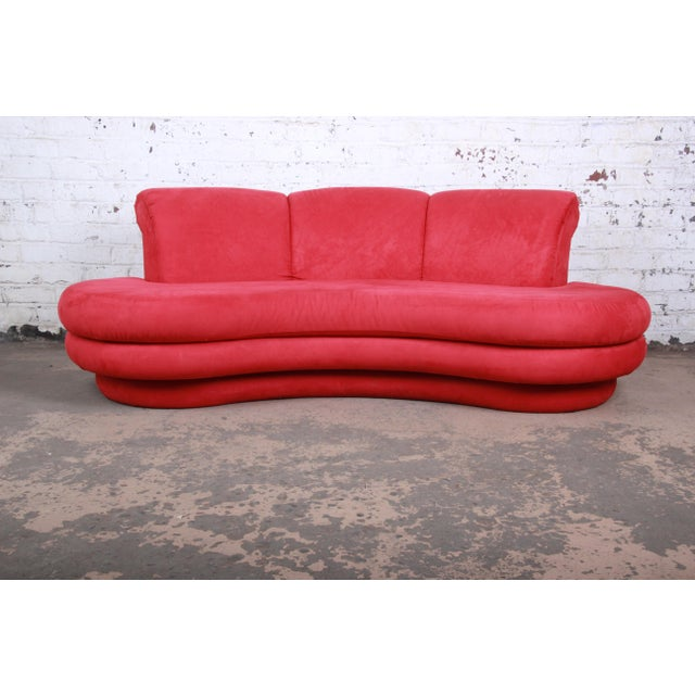 A gorgeous curved cloud sofa designed by Adrian Pearsall for Comfort Designs. The sofa features vibrant red upholstery and...