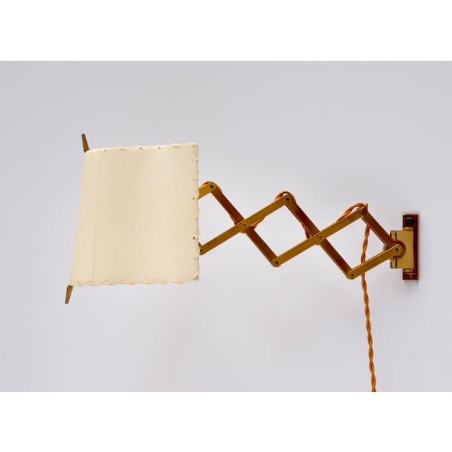 Brass with coated paraffin shade accordion wall lamp for AMBA by Alfred Muller Basel. The brass body will extended to max...