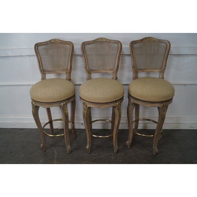 Quality set of 3 French Louis XV style cane back painted swivel bar stools. AGE/COUNTRY OF ORIGIN: Approx 25 years, Italy...