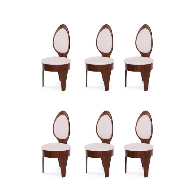 Henry Glass 'spoon' dining chairs circa early 1960's. These examples have sculpted walnut frames and have been newly...