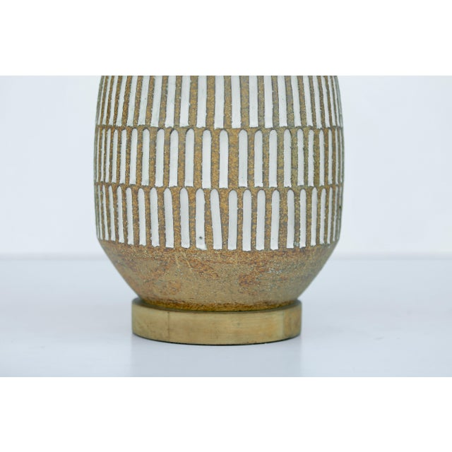 Mid- entury modern California Studio art Pottery. Rewired with double cluster, and silk twist cord. Shade not included,...