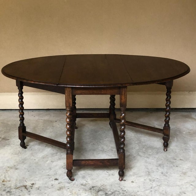 Antique Barley Twist Gateleg Drop Leaf Table provides the essence of why this table design has been so popular for all...