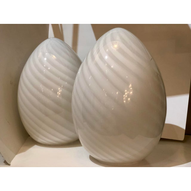 """A beautiful pair of white swirl glass """"egg"""" table lanterns by Itri Verti --Murano. Italy, c. 1980s. When illuminated the..."""