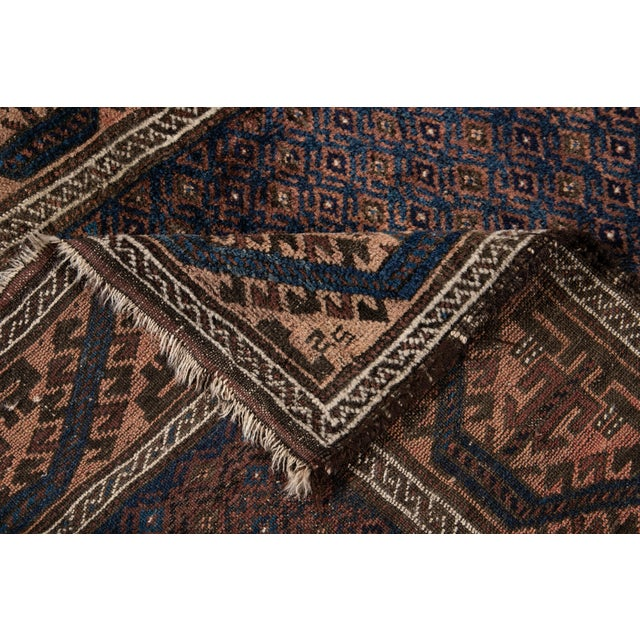 A beautiful Vintage rug with a brownfield in all-over multi medallion design. This rug measures: 3' X 4'4''