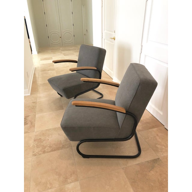 A pair of springer arm chairs in the style of acclaimed designer KEM Webber. These classic, modern chairs are very stylish...