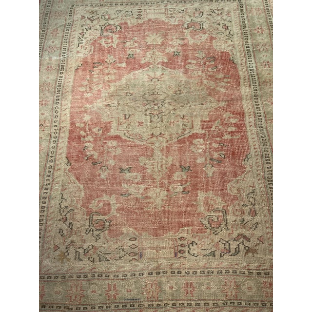 A gorgeous Distressed Oushak area rug. Oushak rugs originated in the small town of Oushak in west-central Anatolia, today...