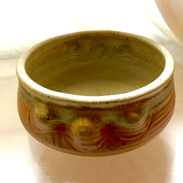 This hand thrown bowl has great color and texture. Instead of handles is has organic shaped grips. It has a makers mark on...