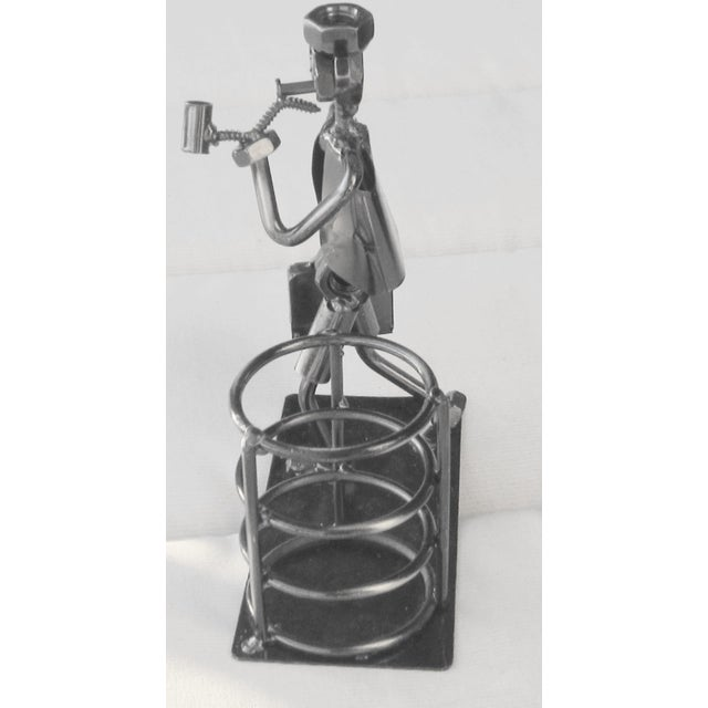 Purchased at Palm Beach Estate sale. Made from metal and bolts and screws. Man carrying briefcase and looks like he is...