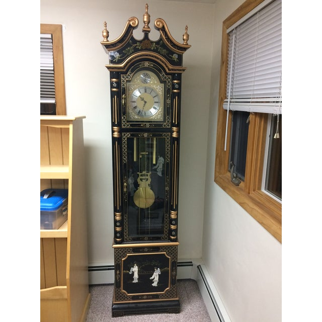 Vintage black lacquer hand-painted Chinese grandfather clock. Three dimensional mother of pearl carved figures on all...