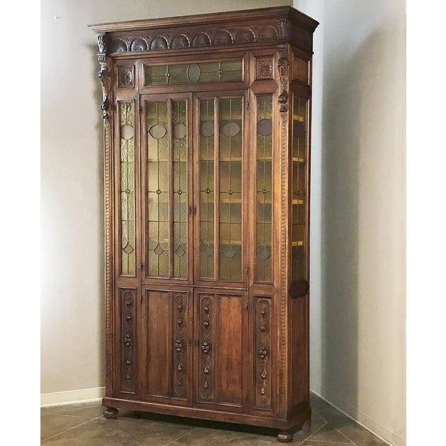 Grand 19th Century Italian Renaissance Stained Glass Bookcase was hand-crafted from walnut for a grand villa in Italy, and...