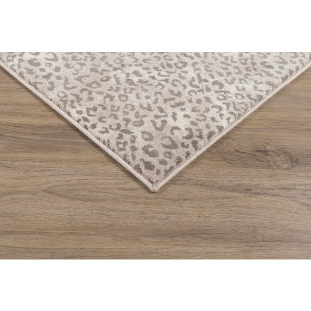 Bring a playful energy into your space with the lively animal print of 'Kalahari Dusk'. The sassy spotting of the rug is...