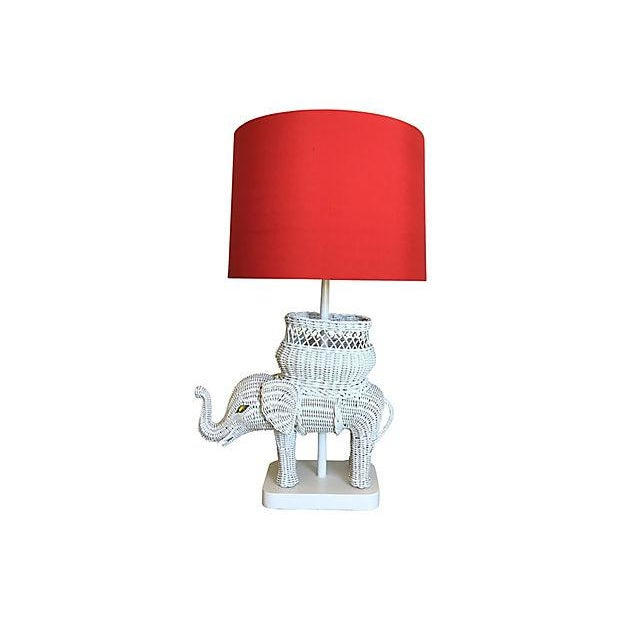 White Elephant! Large and lovely mid-century wicker elephant lamp by Paul Hanson featuring a lucky upraised trunk, woven...