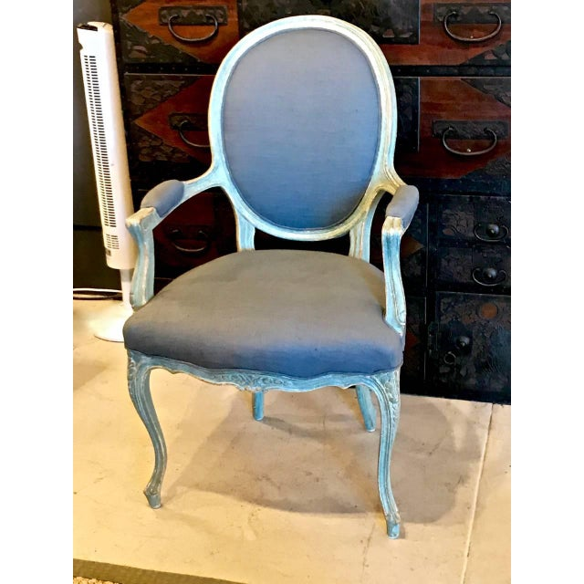 This is a stunning, generously proportioned, pair of painted open armchairs or fauteuils that date to the late 19th or...