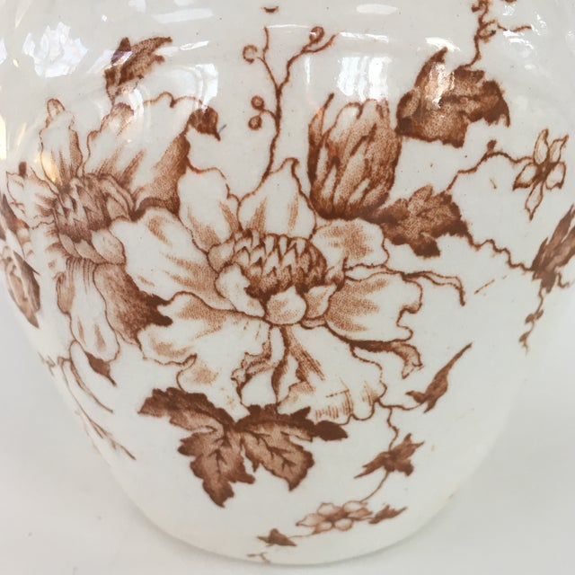 Asthetic movement English brown transferware pitcher. Overall good condition with some staining.