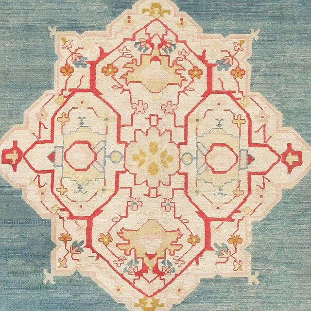 Oushak rug, Turkey, turn of the 20th century. This luxurious antique Turkish rug epitomizes the Provincial style of...