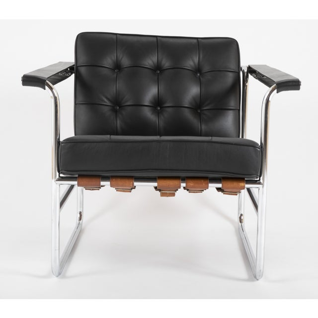 A tubular chromed steel and leather arm chair designed by Hans Eichenberger for De Sede. Known as model HE 113. The straps...