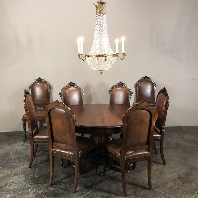 Set of Eight 19th Century French Walnut Dining Chairs feature timeless styling indicative of the waning years of the...