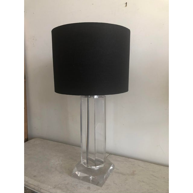 Great looking substantial 1970s Lucite table lamp with black shade. Stand is square with angled corners and the body is...