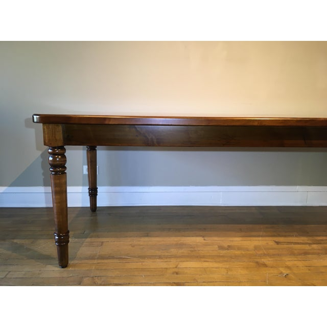 This rustic farmhouse maple dining table made in the French country provincial style has a solid wood top with rounded...