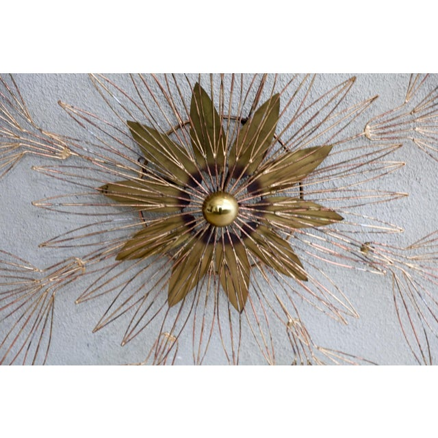 A nice signed Curtis Jere wire wall sculpture in the shape of a star blossom. it is signed and dated 1980. This piece...