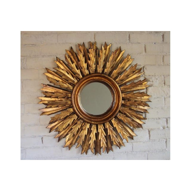 An impressive midcentury French sunburst mirror, circa 1930 with rays arranged in a double layer pattern. Original mirror...