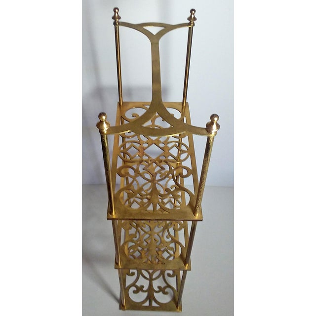 Very unique vintage Peerage Brass, England, freestanding 3 tier brass shelf. The three shelves feature detailed filigree....