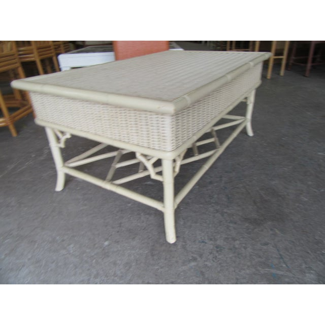 "Wicker Chippendale coffee table. It measures 18"" h X 38"" x 23"" D. IT is in good as found vintage condition."