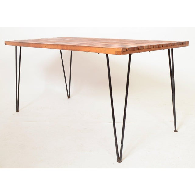 Pipsan Saarinen Slatted Table with Wrought Iron Hair Pin Legs Sol Air was made by Ficks Reed Pipsan Saarinen is the sister...