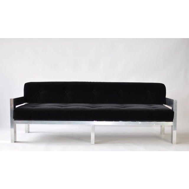 1970s polished aluminum frame sofa. Newly upholstered black velvet.