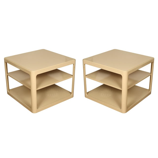 A pair of cream colored, Karl Springer style, painted,three-tiered side tables.