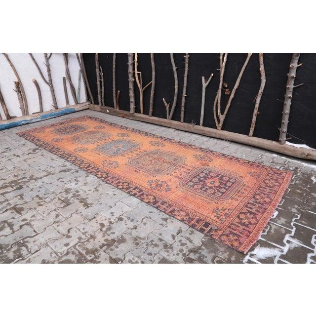 Vintage Turkish Hand-Knotted Wide Runner Rug is a semi-antique vintage rug. '60s Eastern region of Turkey's unique rug is...