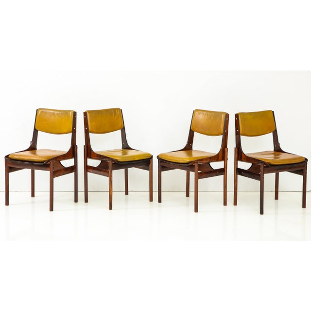 Set of four dining chairs in Jacaranda and Jacaranda plywood with original yellow ochre leather back cushions and loose...